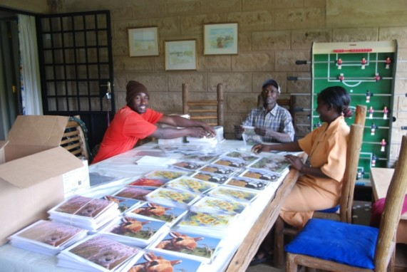 This is a picture of some workers there after an order of cards arrived!